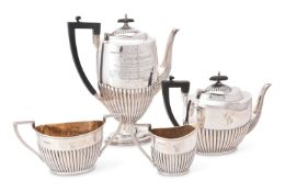 AN EDWARDIAN SILVER OVAL HALF REEDED FOUR PIECE TEA AND COFFEE SERVICE BY WALKER AND HALL