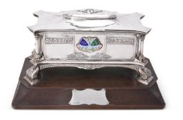 AN ARTS AND CRAFTS SILVER AND ENAMEL SHAPED RECTANGULAR FREEDOM CASKET