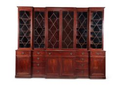 A GEORGE III MAHOGANY TRIPLE BREAKFRONT LIBRARY BOOKCASE