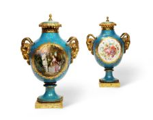 A PAIR OF FRENCH SÈVRES STYLE ORMOLU MOUNTED VASES AND COVERS