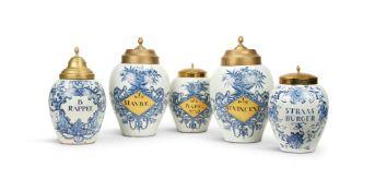 A GARNITURE OF THREE DUTCH DELFT TOBACCO JARS