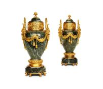 A PAIR OF VERDE ANTICO MARBLE AND GILT METAL MOUNTED URNS