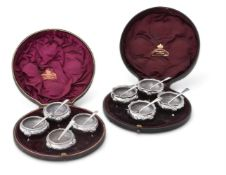 TWO MATCHED SETS OF FOUR VICTORIAN SILVER CAULDRON SALT CELLARS