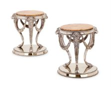 A PAIR OF VICTORIAN ELECTRO-PLATED AND MARBLE MOUNTED CIRCULAR STANDS