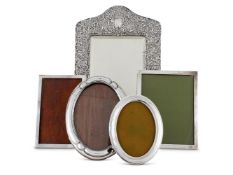 FIVE VARIOUS SILVER FRAMES THE FIRST WITH A BEVELLED MIRROR BY HENRY MATTHEWS