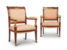 A PAIR OF FRENCH MAHOGANY AND ORMOLU MOUNTED OPEN ARMCHAIRS