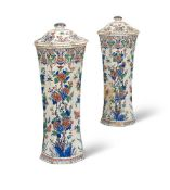 A PAIR OF DUTCH DELFT WAISTED RIBBED VASES AND COVERS
