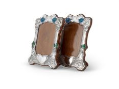 A PAIR OF ARTS AND CRAFTS SILVER PHOTOGRAPH FRAMES BY HENRY MATTHEWS