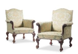 A PAIR OF GEORGE II STYLE CARVED MAHOGANY LIBRARY ARMCHAIRS
