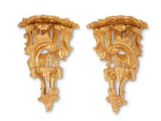 A PAIR OF GEORGE III CARVED GILTWOOD WALL BRACKETS