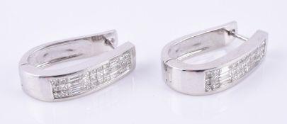 A pair of diamond hoop earrings