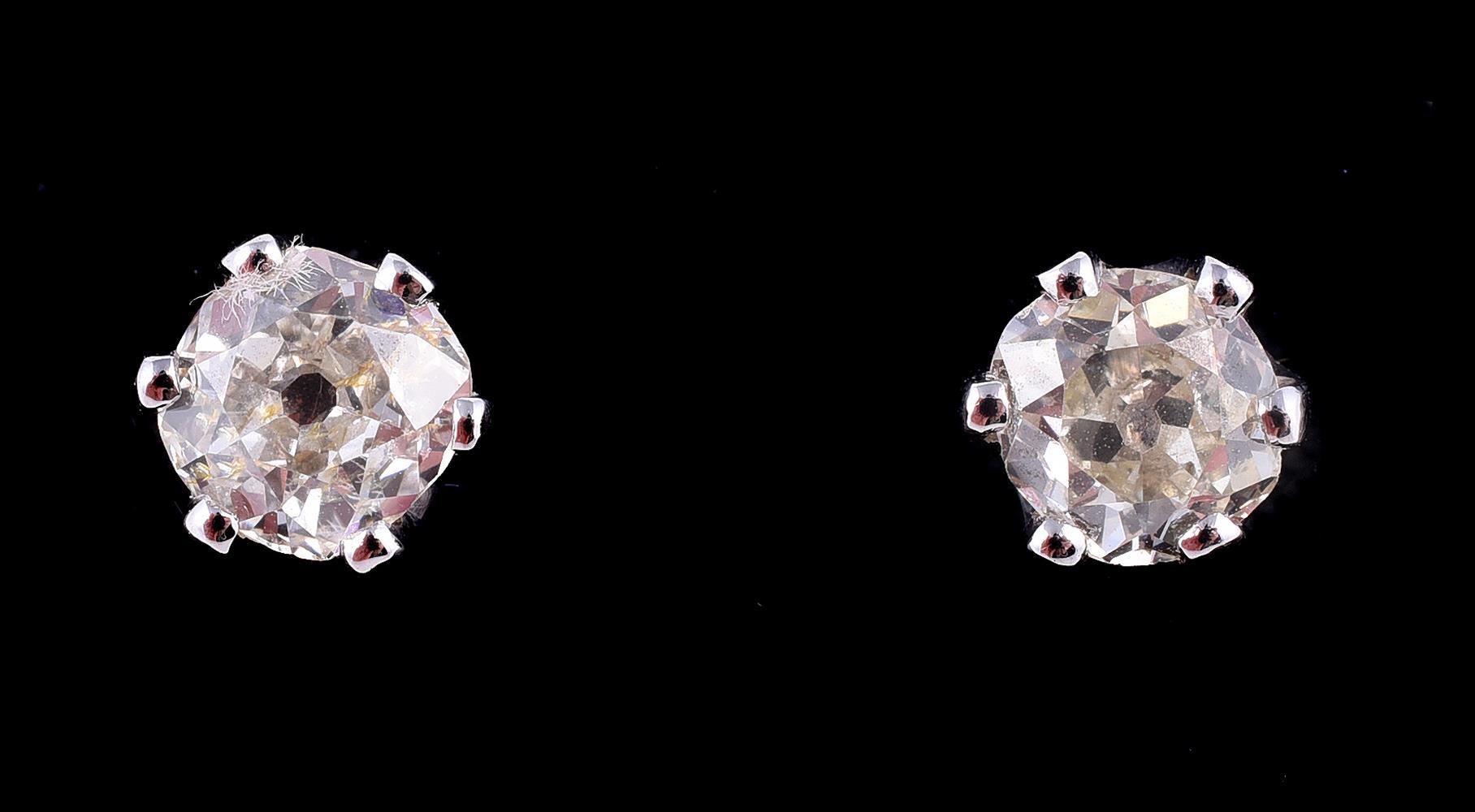 A pair of single stone diamond ear studs