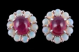A pair of opal and ruby cluster earrings