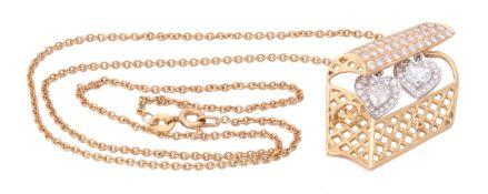 A diamond treasure chest pendant