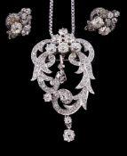 A scrolled diamond pendant