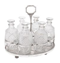 Y A cased George III silver mounted oval six bottle decanter stand