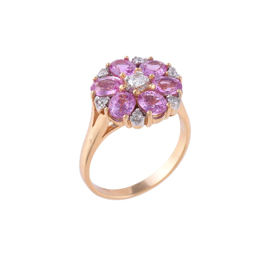 A diamond and pink sapphire flower head cluster ring