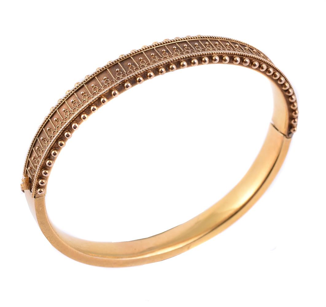 A mid 19th century gold Etruscan style bangle