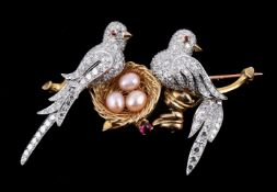 A diamond, ruby and simulated pearl lovebirds brooch