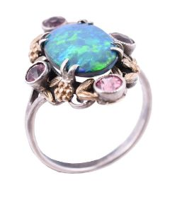 An Arts and Crafts opal doublet and pink tourmaline dress ring in the manner of Bernard Instone