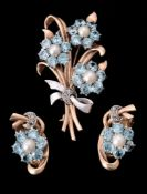 A mid 20th century blue zircon, cultured pearl and rose cut diamond floral spray brooch and matching