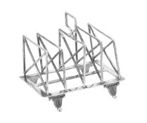 An Edwardian silver four division toast rack by William Hutton & Sons