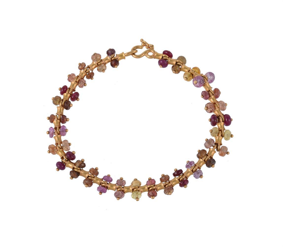 A gold coloured beaded bracelet