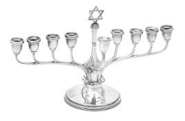 A silver nine branch Menorah by Adie Bros. Ltd.