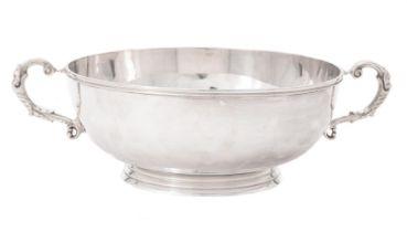 A silver twin handled bowl by Harrods Ltd.