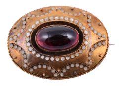 A mid Victorian garnet and enamel oval brooch