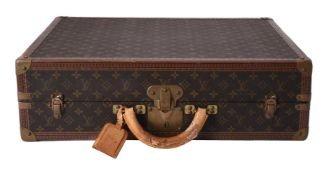 Louis Vuitton, a Monogrammed coated canvas and leather suitcase
