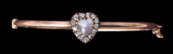 A late Victorian diamond and moonstone hinged bangle
