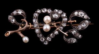 A late Victorian rose cut diamond and pearl mistletoe and heart brooch