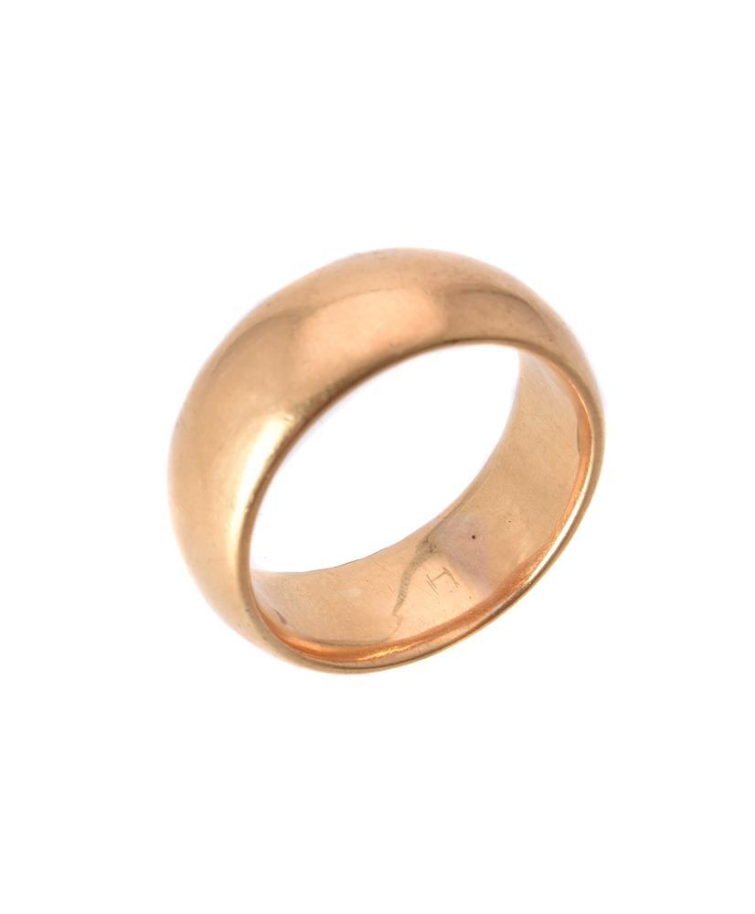 An 18 carat gold broad band ring
