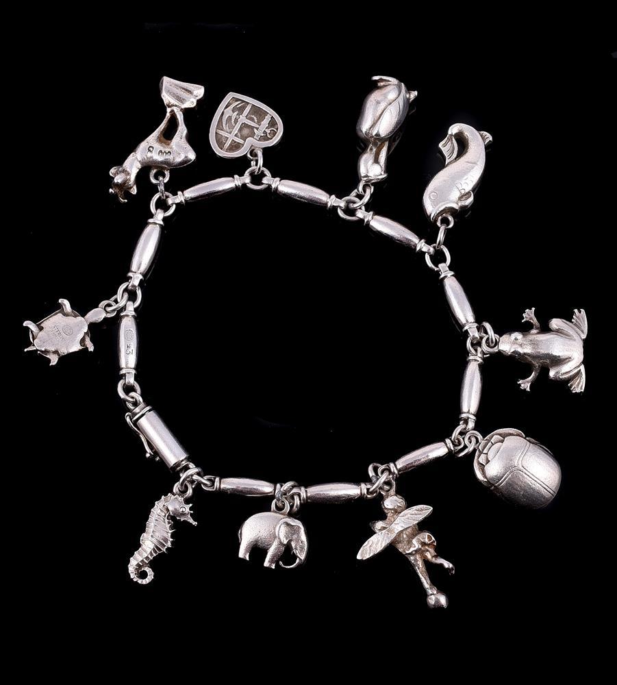 A silver coloured charm bracelet by Henry Pilstrup for Georg Jensen