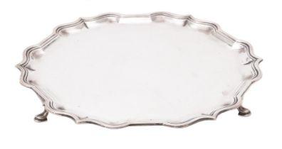 A silver shaped circular salver by Harrods Ltd.