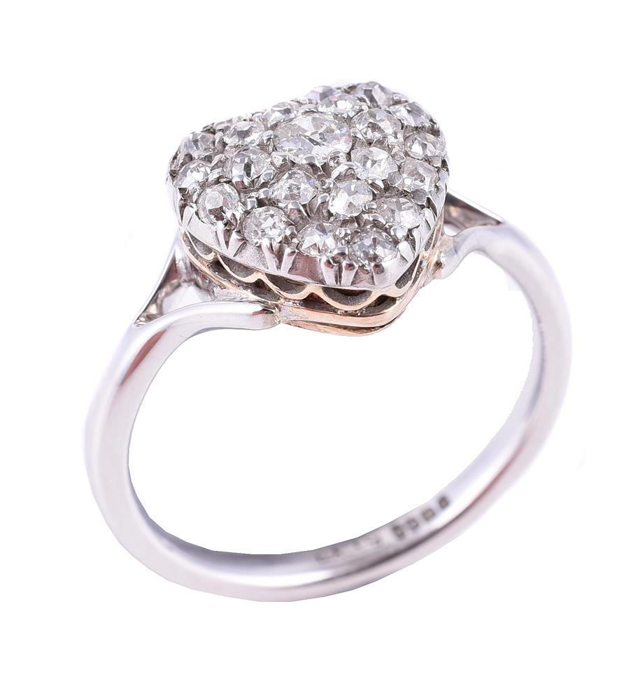 A heart shaped cluster ring