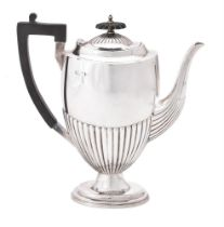 A late Victorian silver half gadrooned coffee pot by Walker & Hall