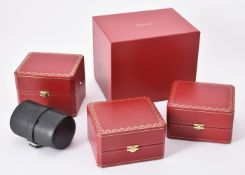 Cartier, a red leather watch box