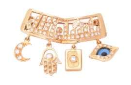 A Bismillah brooch retailed by Mouawad Boutique