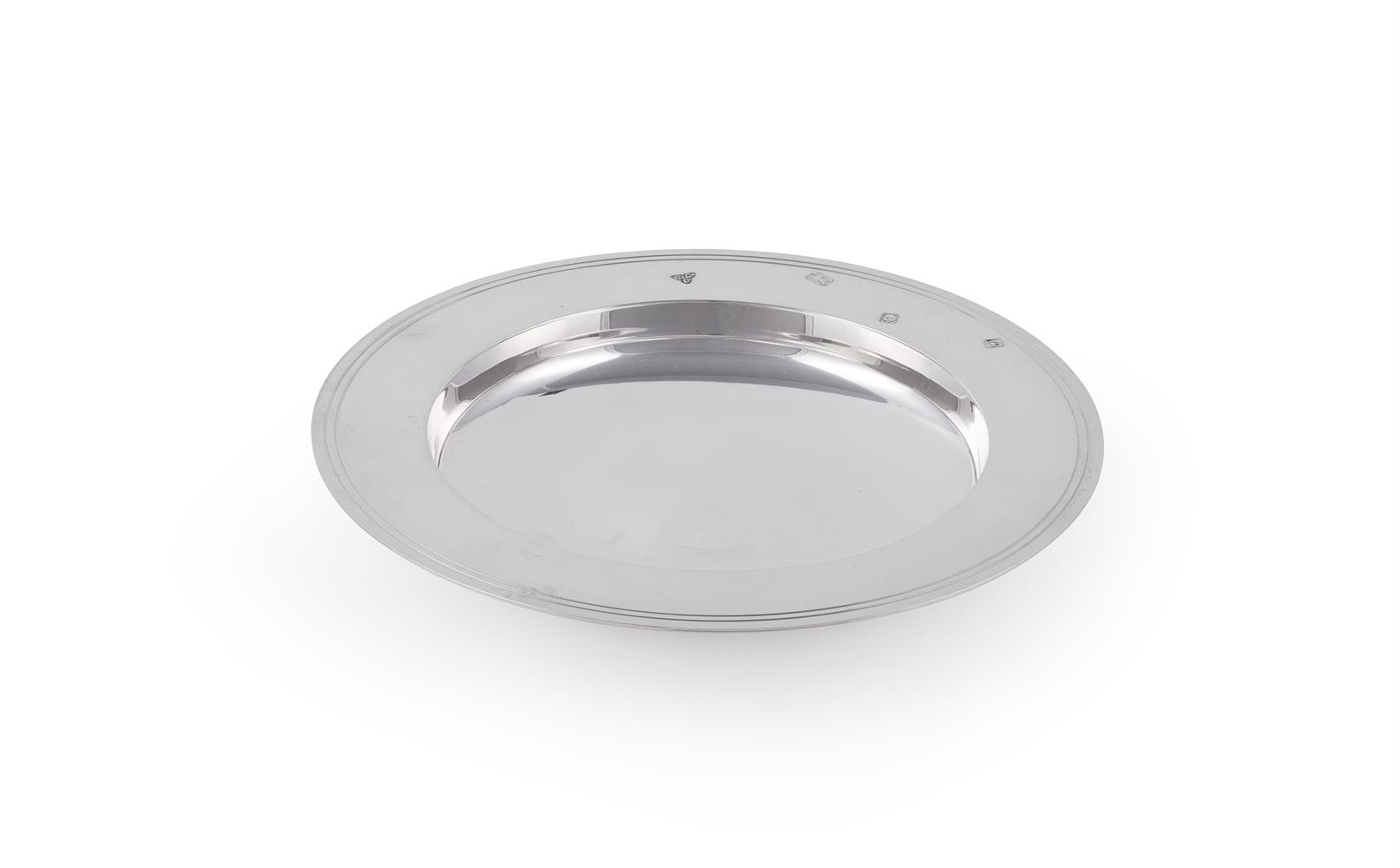 A silver armada dish by Garrard & Co.