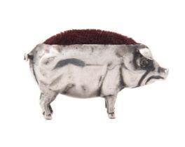 An Edwardian silver novelty pig pin cushion by Sydney & Co.