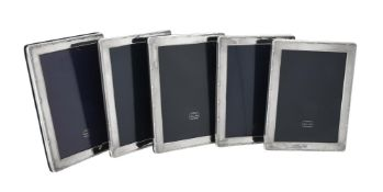 Five silver mounted rectangular photo frames by Kitney & Co.
