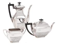 A late Victorian silver three piece half gadrooned tea and coffee set by Atkin Brothers