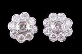 A pair of diamond flower head cluster earrings