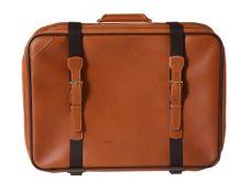 Louis Vuitton, a tan leather suitcase