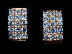 A pair of blue topaz earrings