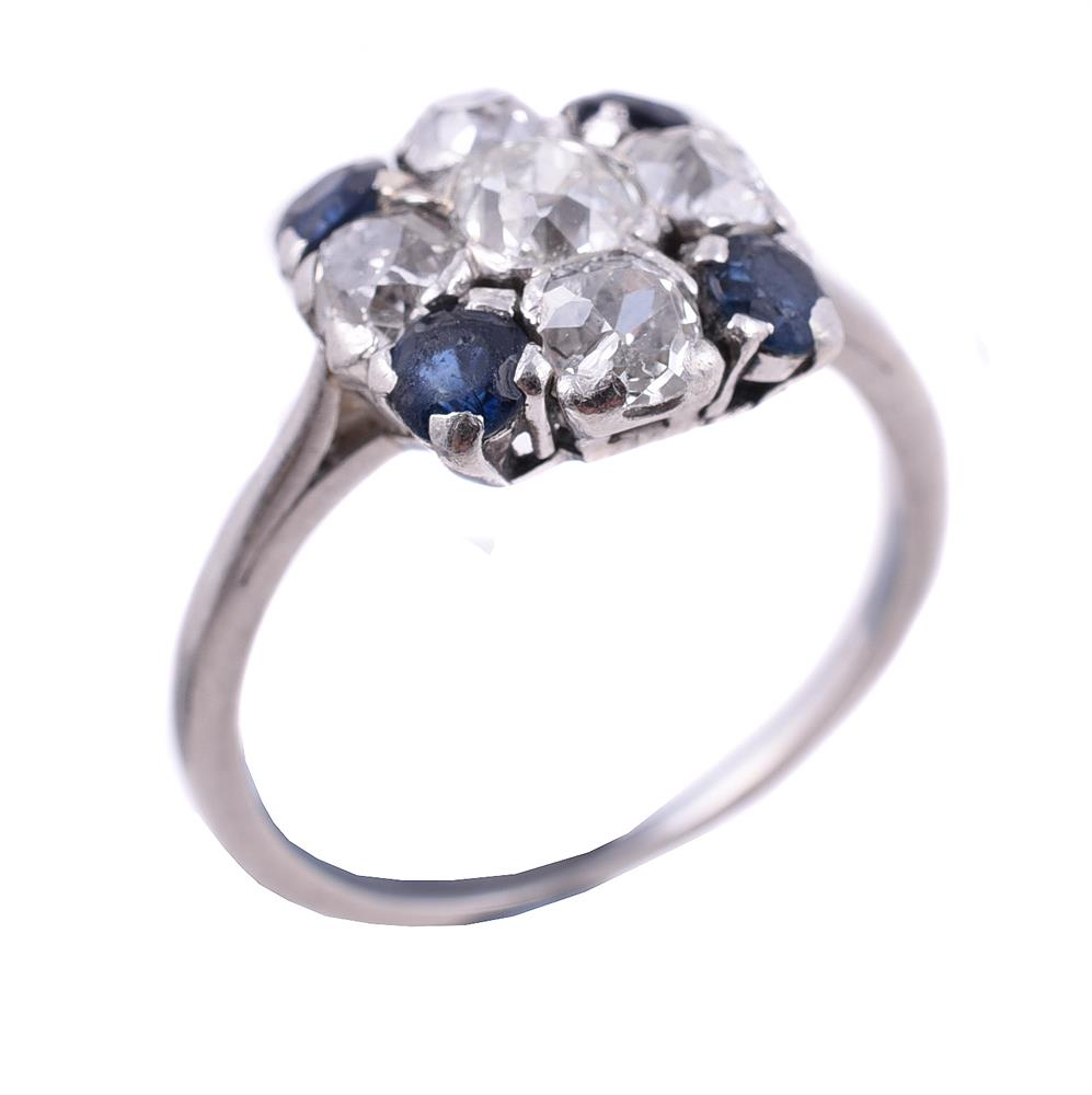 A sapphire and diamond cross cluster ring