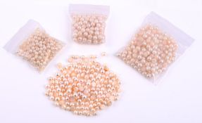 † A quantity of drilled cultured pearls
