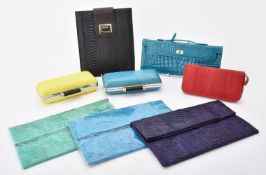 Y Three unmarked snakeskin clutch bags